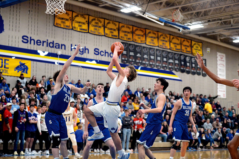 Joel moline | The Sheridan Press<br /> Sheridan's Reed Rabon (4) drives in for a layup against Billings Skyview High School Friday, Jan. 17, 2020.