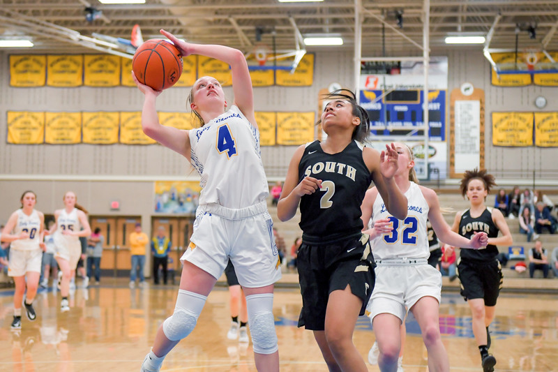 Joel Moline | The Sheridan Press<br>Sheridan's Annie Mitzel (4) goes up for a layup in action against Cheyenne South High School Friday, Feb. 14, 2020.