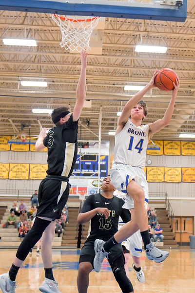 Joel Moline | The Sheridan Press<br>Sheridan's Ethan Kutz (14) goes up for a layup in action against Cheyenne South High School Friday, Feb. 14, 2020.
