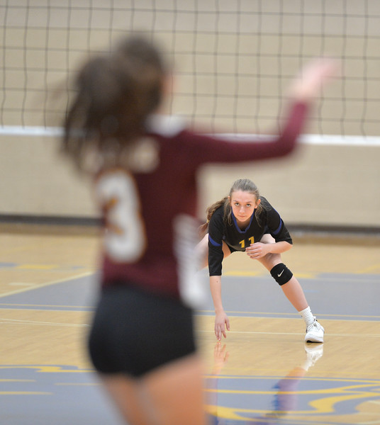 Bud Denega | The Sheridan Press<br /> Sheridan's Brooklyn Bowie prepares to receive a serve during a game against Laramie at Sheridan High School Saturday, Oct. 13, 2018. The Lady Broncs rallied in the fourth set to defeat the Lady Plainsmen.