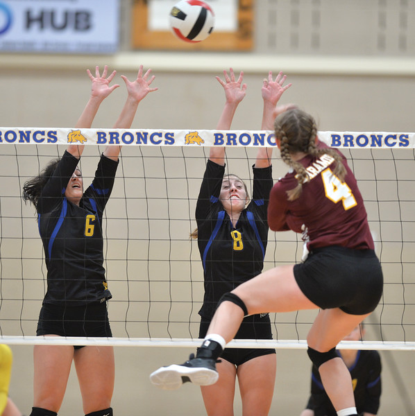 Bud Denega | The Sheridan Press<br /> Sheridan's Madyson Godwin, left, and Abby Sanders go up for a block during a game against Laramie at Sheridan High School Saturday, Oct. 13, 2018. The Lady Broncs needed a total of seven sets to defeat Cheyenne South and Laramie Friday and Saturday.