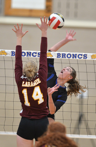 Bud Denega | The Sheridan Press<br /> Sheridan's Abby Sanders rises for a hit during a game against Laramie at Sheridan High School Saturday, Oct. 13, 2018. The Lady Broncs took the first two sets and the fourth to defeat the Lady Plainsmen.
