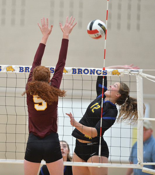 Bud Denega | The Sheridan Press<br /> Sheridan's Jordan Christensen rises for a hit during a game against Laramie at Sheridan High School Saturday, Oct. 13, 2018. The Lady Broncs downed the Lady Plainsmen 3-1 to earn their second win in as many nights.