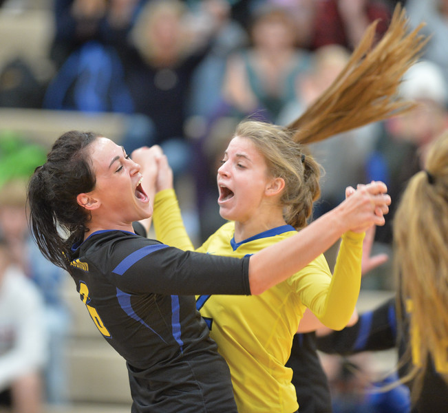 Bud Denega | The Sheridan Press<br /> Madyson Godwin, left, celebrates with Talia Steel during a game against Laramie at Sheridan High School Saturday, Oct. 13, 2018. The Lady Broncs rallied in the fourth set to defeat the Lady Plainsmen.