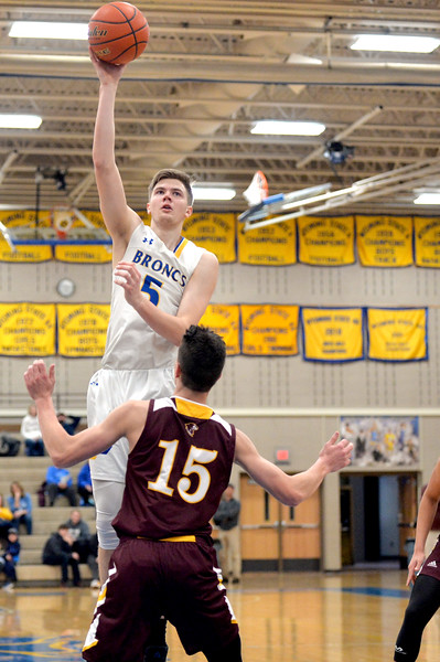 Joel Moline | The Sheridan Press<br /> Sheridan's Gus Wright (5) rises above the defense for a hook shot against Laramie High School Saturday, Feb. 15, 2020.