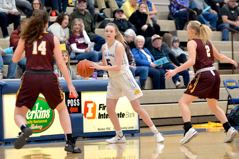 Joel Moline | The Sheridan Press<br /> Sheridan's Bree Aksamit (5) looks to pass the ball before the trap reaches her against Laramie High School Saturday, Feb. 15, 2020.