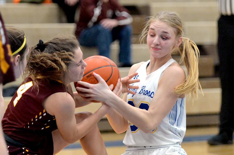 Joel Moline | The Sheridan Press<br /> Sheridan's Katie Ligocki (33) wrestles the ball from Laramie's Jayla Wulff (4) Saturday, Feb. 15, 2020.