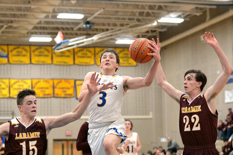 Joel Moline | The Sheridan Press<br /> Sheridan's Zach Koltsika (3) drives in for a layup against Laramie High School Saturday, Feb. 15, 2020.