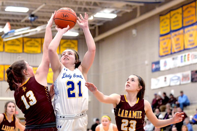 Joel Moline | The Sheridan Press<br /> Sheridan's Mollie Morris (21) has her shot tipped against Laramie High School Saturday, Feb. 15, 2020.
