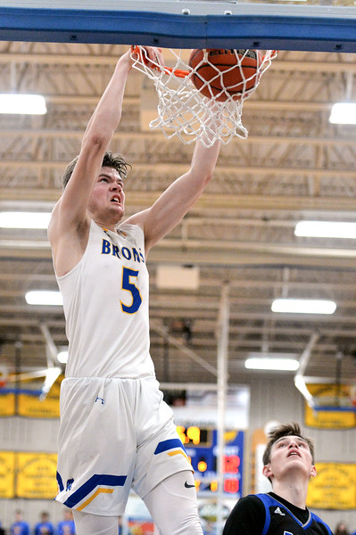 Joel Moline | The Sheridan Press<br /> Sheridan's Gus Wright (5) dunks the ball to help seal the win in overtime against Thunder Basin High School Friday, Jan. 24, 2020.