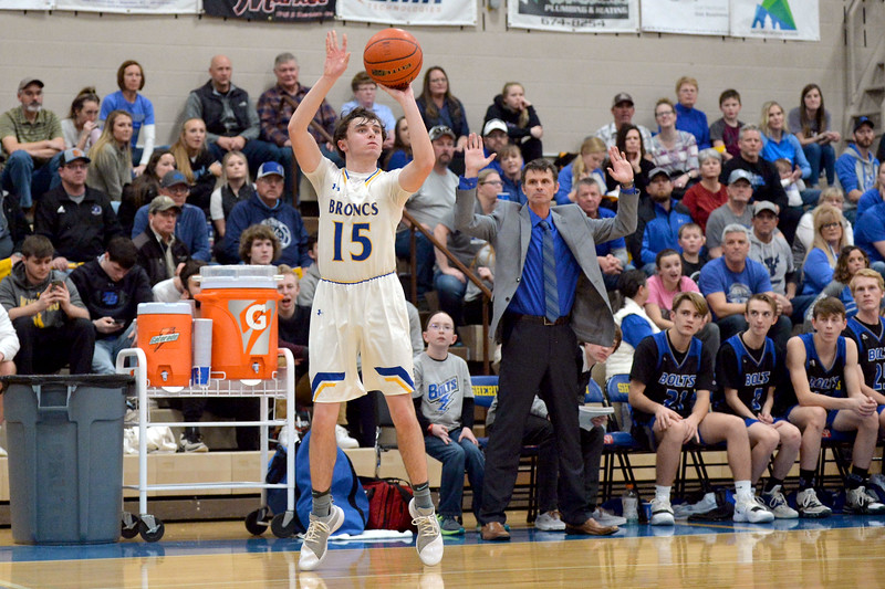 Joel Moline | The Sheridan Press<br /> Sheridan's Carter Dubberley (15) makes a 3-pointer against Thunder Basin High School Friday, Jan. 24, 2020.