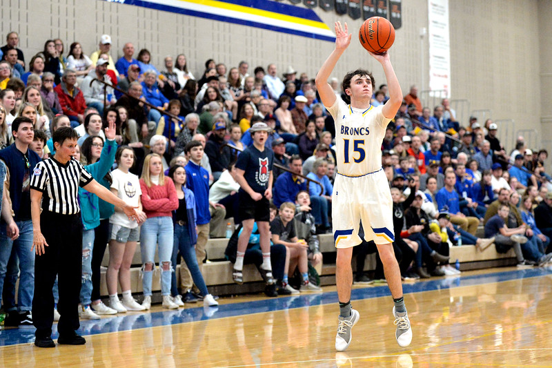 Joel Moline | The Sheridan Press<br /> Sheridan's Carter Duberley (15) makes a 3-pointer late in the game to cut into the lead during the game against Thunder Basin High School Friday, Jan. 24, 2020.