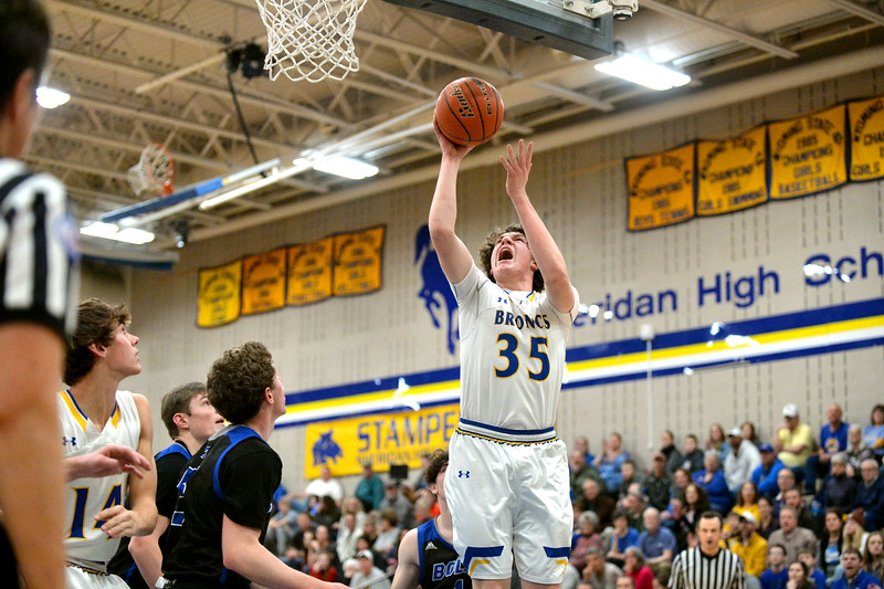 Joel Moline | The Sheridan Press<br /> Sheridan's Sam Lecholat (35) scores a layup against Thunder Basin High School Friday, Jan. 24, 2020.