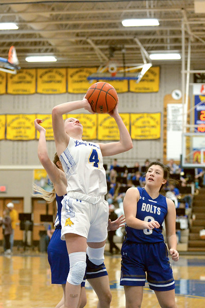 Joel Moline | The Sheridan Press<br /> Sheridan's Annie Mitzel (21) attempts a layup against Thunder Basin High School Friday, Jan. 24, 2020.