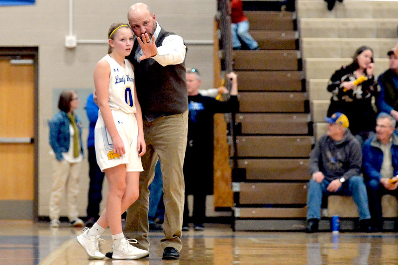 Joel Moline | The Sheridan Press<br /> Sheridan's Gillian Mitzel (0) receives instruction from head coach Larry Ligocki during the game against Thunder Basin High School Friday, Jan. 24, 2020.