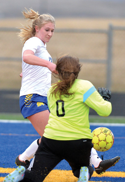 Bud Denega | The Sheridan Press<br /> Sheridan's Bridgette Maxey tries to beat Buffalo goalie Calli Bangs in a game played at Homer Scott Field Tuesday, March 27, 2018. The Lady Broncs downed the Lady Bison 4<br /> -1.