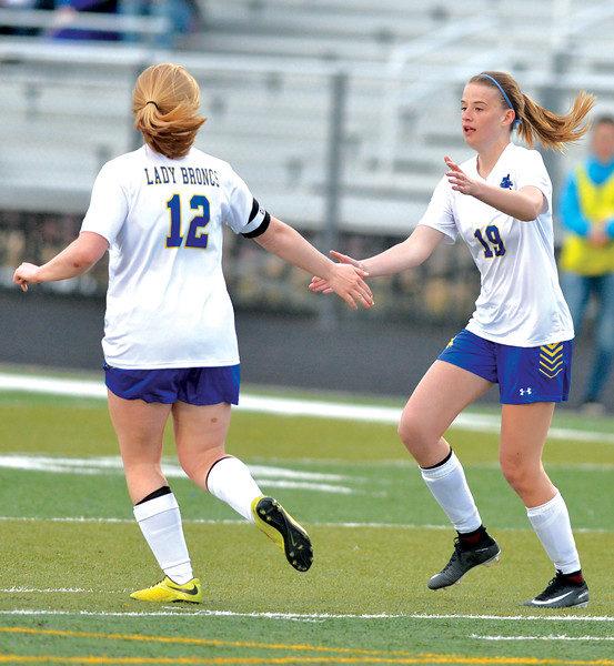 Bud Denega | The Sheridan Press<br /> Sheridan's Amanda Buckler, right, celebrates with Katie Tomlinson after a goal in a game against Buffalo at Homer Scott Field Tuesday, March 27, 2018. The Lady Broncs toppled the Lady Bison 4-1.