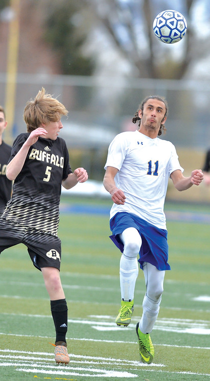 Bud Denega | The Sheridan Press<br /> Bryce Taylor looks to head the ball during the Broncs' game against Buffalo at Homer Scott Field Tuesday, March 27, 2018. Sheridan edged the Bison 2-1.