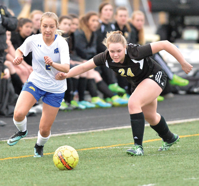 Bud Denega   The Sheridan Press<br /> Sheridan's Maddy Estes races to beat Buffalo's Morgan Pfister to the ball during a game at Homer Scott Field Tuesday, March 27, 2018. The Lady Broncs beat the Lady Bison 4-1.