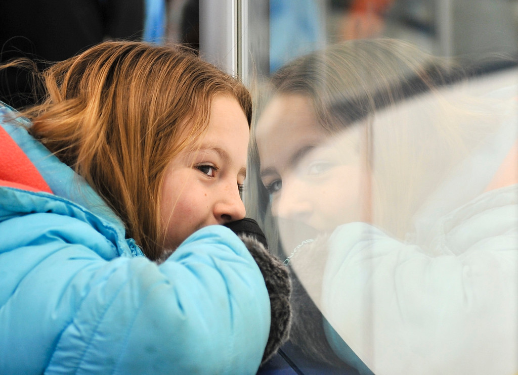 Justin Sheely   The Sheridan Press<br /> Nine-year-old Harlee Roberts of Pine Dale looks through the glass during the WAHL High School B State Tournament at Whitney Ice Rink in the M&M's Center Saturday, Feb. 24, 2018.