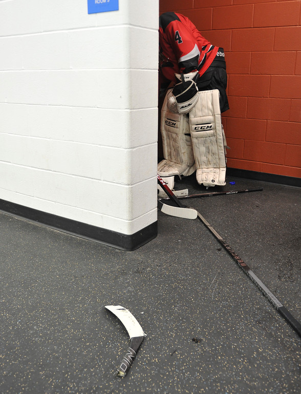 Justin Sheely   The Sheridan Press<br /> A Riverton player takes a moment outside the locker room after the team was upset by Douglas during the WAHL High School B State Tournament at Whitney Ice Rink in the M&M's Center Saturday, Feb. 24, 2018.