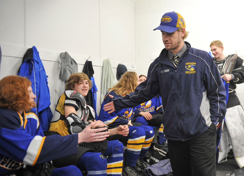 Justin Sheely   The Sheridan Press<br /> Hawks head coach Kirk Viren greets the players during the WAHL High School B State Tournament at Whitney Ice Rink in the M&M's Center Saturday, Feb. 24, 2018.