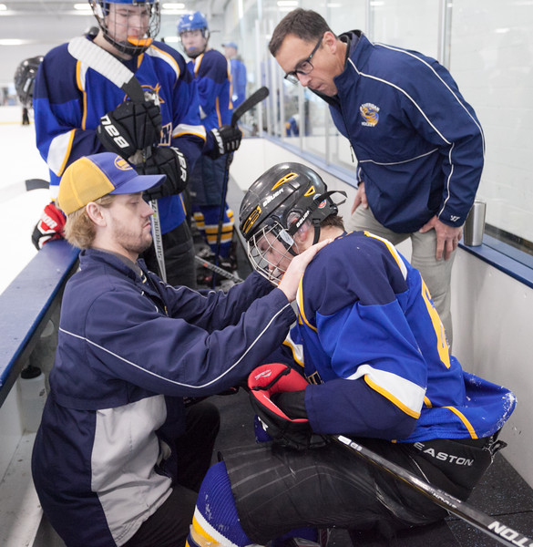 Tibby McDowell | The Sheridan Press<br /> Coaches Kirk Viren, left, and John Chase, right, asses if Jack Chase has an injury during the semi-finals of the state tournament at Whitney Rink at the M&M's Center Saturday Feb. 24, 2018.