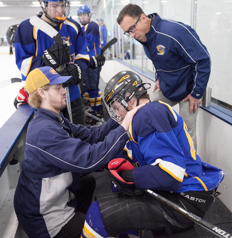 Tibby McDowell   The Sheridan Press<br /> Coaches Kirk Viren, left, and John Chase, right, asses if Jack Chase has an injury during the semi-finals of the state tournament at Whitney Rink at the M&M's Center Saturday Feb. 24, 2018.