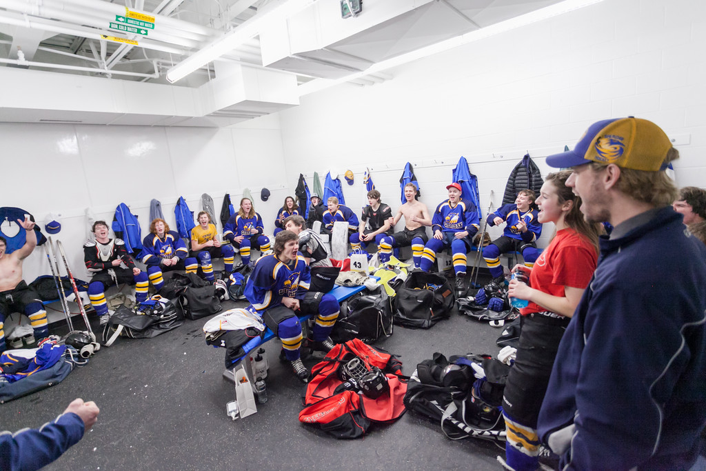 Tibby McDowell   The Sheridan Press<br /> The Sheridan Hawks celebrate in the locker room after beating the Pinedale Glaciers in the semi-finals of the state tournament at Whitney Rink at the M&M's Center Saturday Feb. 24, 2018.  The Sheridan Hawks advance to the finals with a 3-2 win over the Pinedale Glaciers.