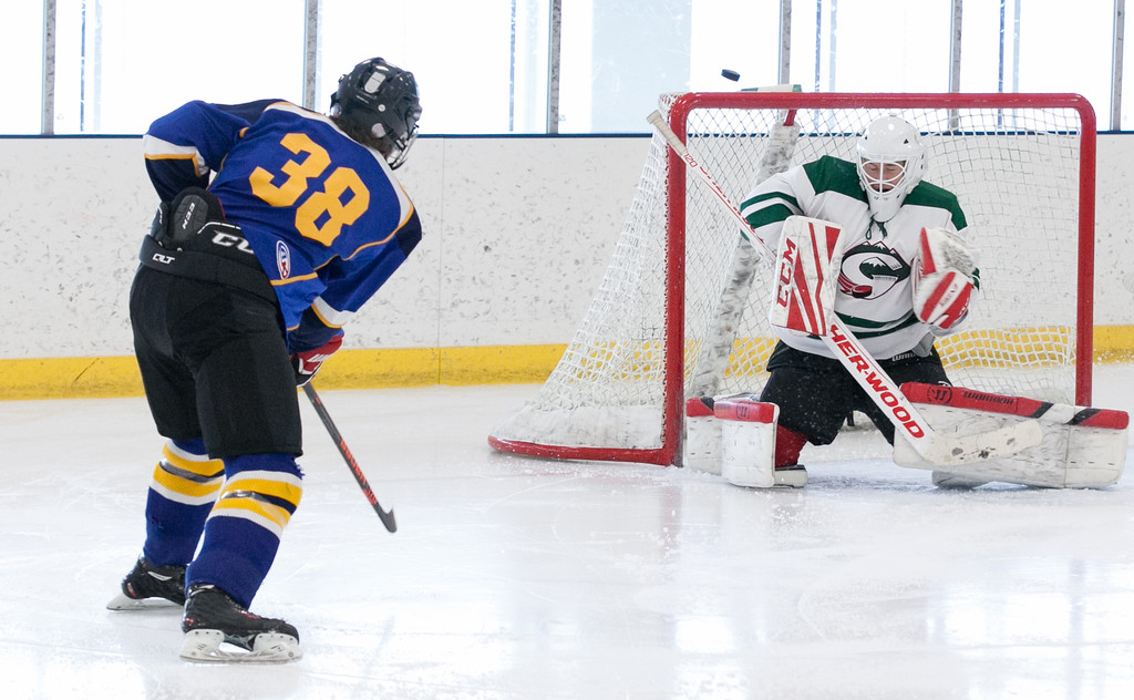 Tibby McDowell   The Sheridan Press<br /> Gunnar Swanson (38) narrowly misses a shot on goal against Pinedale in the semi-finals of the state tournament at Whitney Rink at the M&M's Center Saturday Feb. 24, 2018.