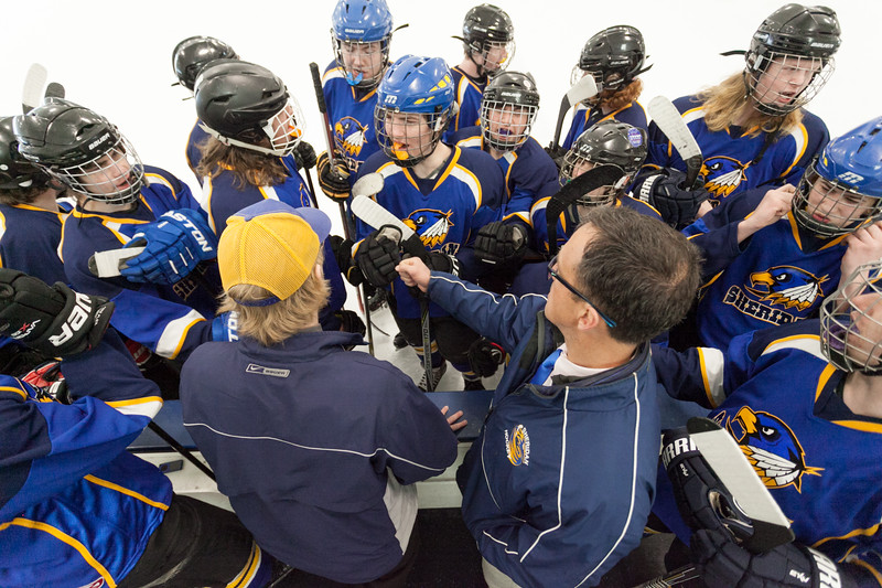 Tibby McDowell | The Sheridan Press<br /> The Sheridan Hawks get pumped up by coaches Kirk Viren and John Chase prior to taking the ice against Pindale in the semi-finals of the state hockey tournament at Whitney Rink at the M&M's Center Saturday Feb. 24, 2018.