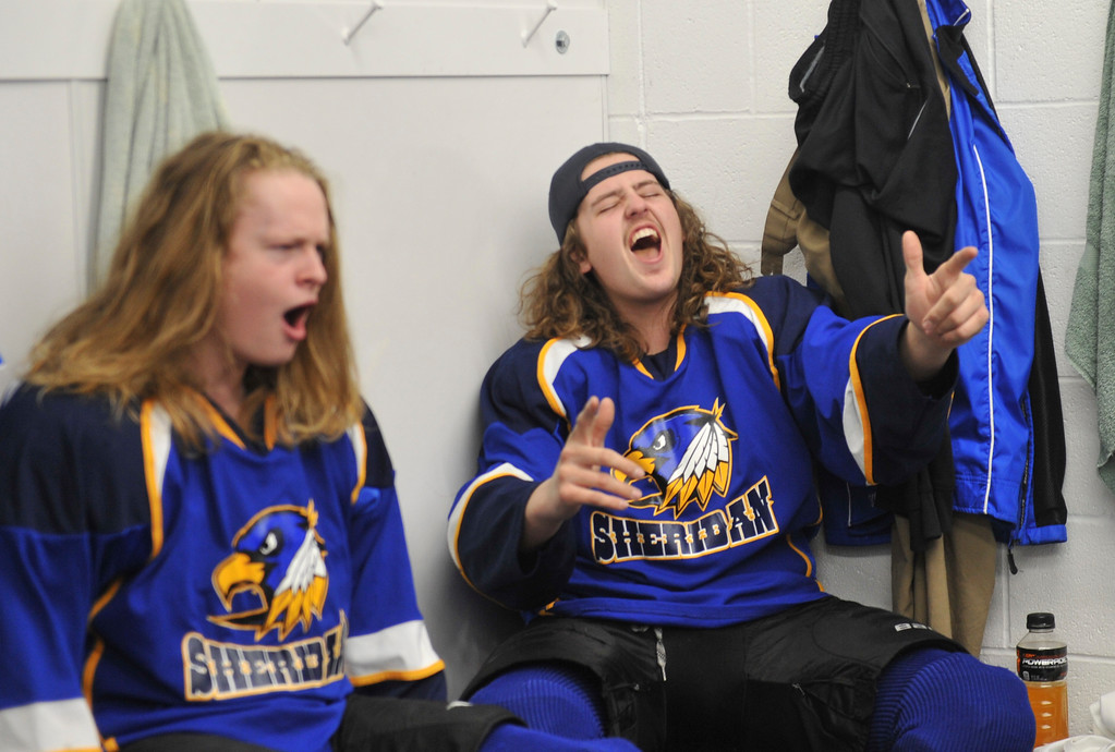 Justin Sheely   The Sheridan Press<br /> Sheridan's Justin Bailey, right, and Walker Billings get pumped up to a song playing in the locker room during the WAHL High School B State Tournament at Whitney Ice Rink in the M&M's Center Saturday, Feb. 24, 2018.
