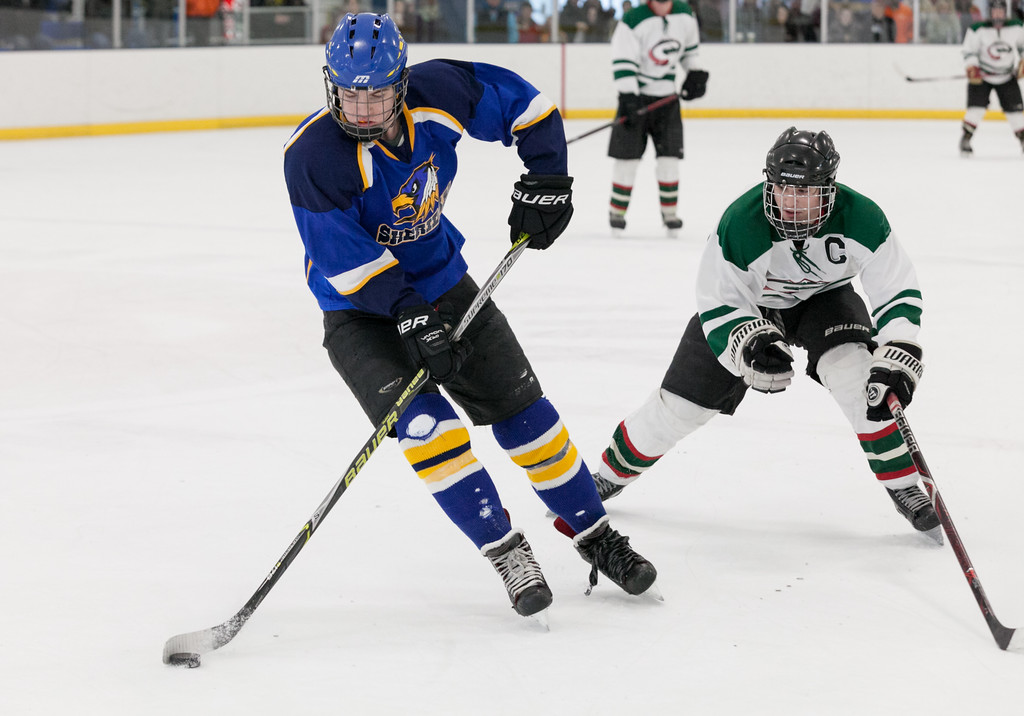 Tibby McDowell   The Sheridan Press<br /> Ben Lavigne keeps the puck from Pinedale during the semi-finals of the state tournament at Whitney Rink at the M&M's Center Saturday Feb. 24, 2018.