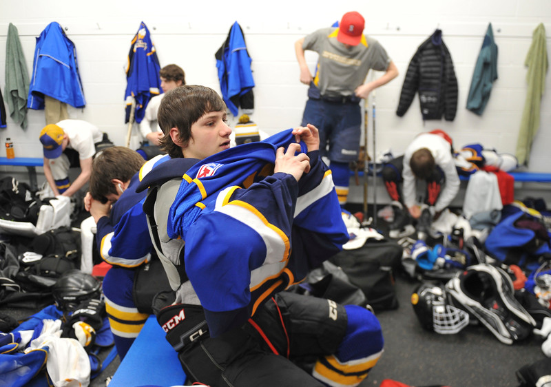 Justin Sheely | The Sheridan Press<br /> Sheridan's Hunter Swanson pulls his jersey on in the Hawks locker room during the WAHL High School B State Tournament at Whitney Ice Rink in the M&M's Center Saturday, Feb. 24, 2018.