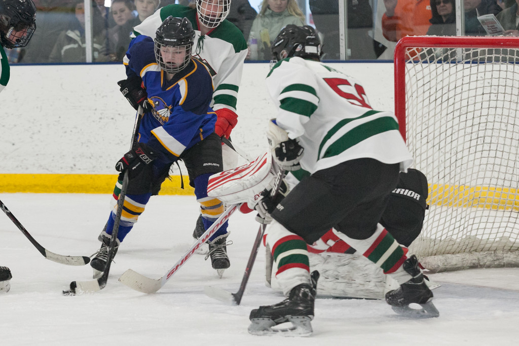 Tibby McDowell   The Sheridan Press<br /> Camdyn Cook positions the puck in front of Pinedale's goal at Whitney Rink at the M&M's Center Saturday Feb. 24, 2018.