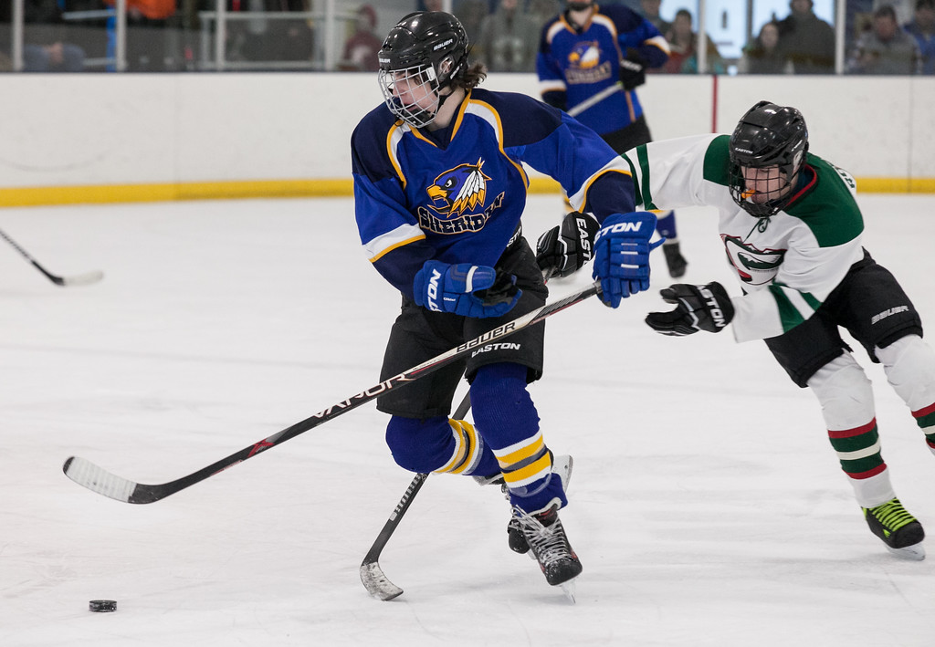 Tibby McDowell   The Sheridan Press<br /> Gavin Jones gets in front of a Pinedale defender during the semi-finals of the state tournament at Whitney Rink at the M&M's Center Saturday Feb. 24, 2018.