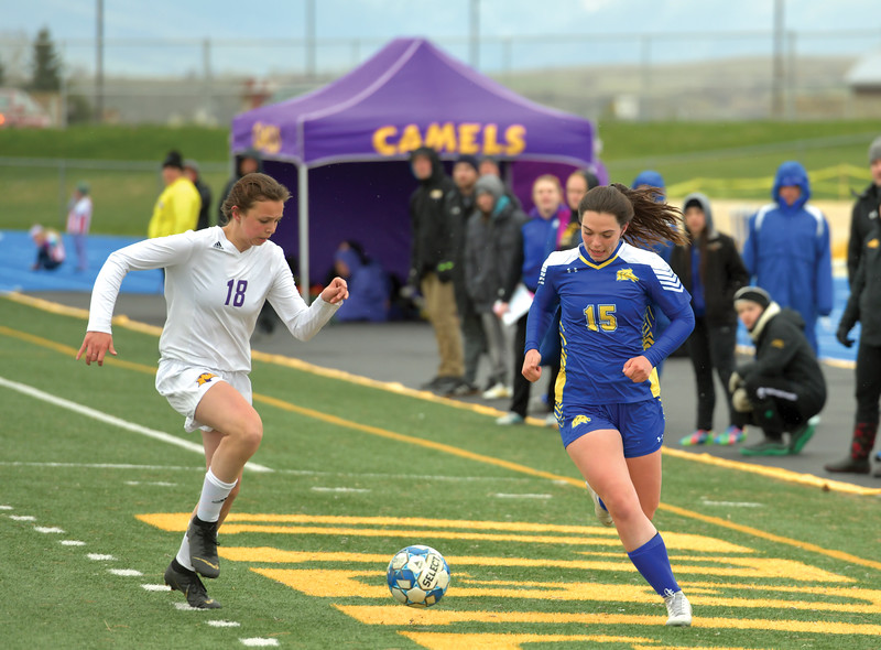 Matthew Gaston | The Sheridan Press<br>Sheridan's Aniston Beard (15) battles for possession with Campbell County's Ashley McNally (18) during play Tuesday, April 30, 2019. The Lady Broncs won 2-0.