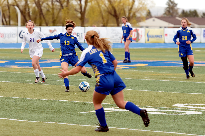 Matthew Gaston | The Sheridan Press<br>Sheridan's Courtney Wallach (13) passes the ball up the pitch during play against Campbell County at Homer Scott Field Tuesday, April 30, 2019. The Lady Broncs won 2-0.