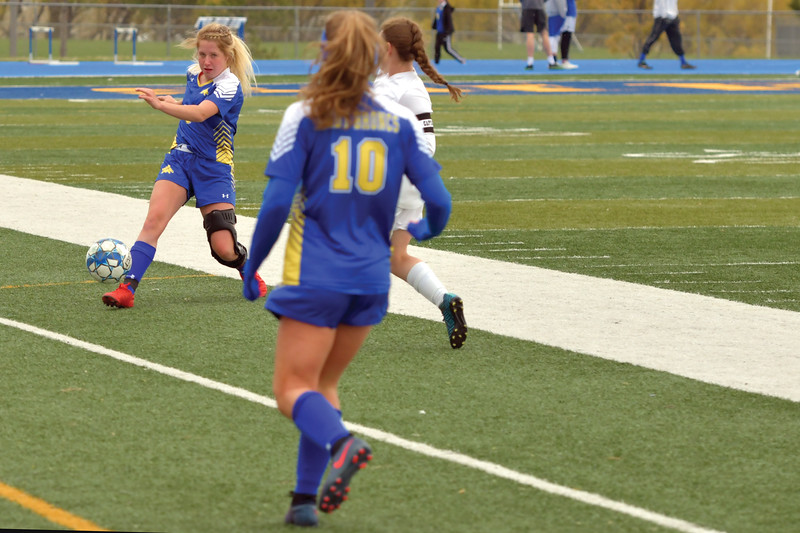 Matthew Gaston | The Sheridan Press<br>Sheridan's Nichole Johnson (3) chips a pass past the defender to Aria Heyneman (10) during play against Campbell County Tuesday, April 30, 2019. The Lady Broncs won 2-0.