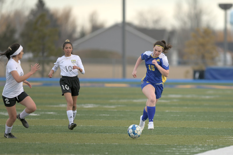 Matthew Gaston | The Sheridan Press<br>Sheridan's Aniston Beard (15) gets the break away against Cheyenne South at Homer Scott Field Friday, March 22, 2019. The Lady Broncs beat the Lady Bison 3-0.