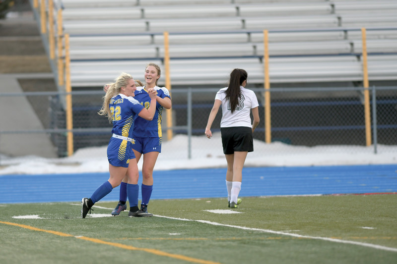 Matthew Gaston | The Sheridan Press<br>Sheridan's Braylee Standish (22) and Aria Heyneman (10) celebrate after Standish scored the first goal of the game against Cheyenne South Friday, March 22, 2019. The Lady Broncs beat the Lady Bison 3-0.