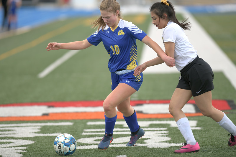 Matthew Gaston | The Sheridan Press<br>Sheridan's Aria Heyneman (10) beats a defender and sends the ball down the pitch at Homer Scott Field Friday, March 22, 2019. The Lady Broncs beat the Lady Bison 3-0.
