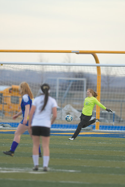 Matthew Gaston | The Sheridan Press<br>Sheridan's goalkeeper Libby Gardner (00) clears the ball out of the box at Homer Scott Field Friday, March 22, 2019. The Lady Broncs defeated Cheyenne South 3-0.