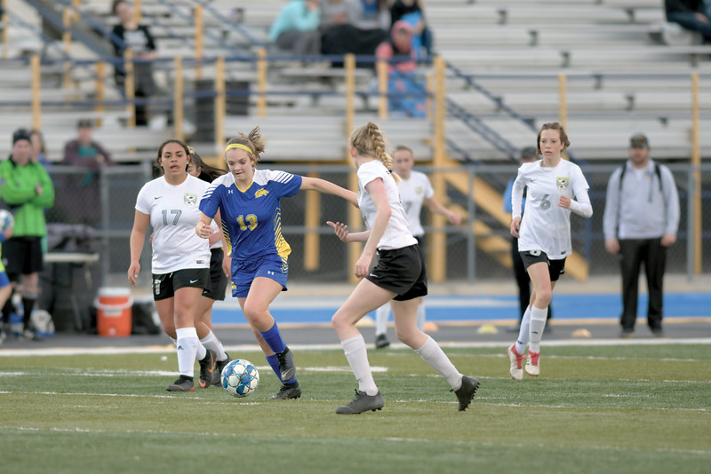 Matthew Gaston | The Sheridan Press<br>Sheridan's Courtney Wallach (13) splits the defense to bring the ball down the pitch at Homer Scott Field Friday, March 22, 2019. The Lady Broncs beat the Lady Bison 3-0.