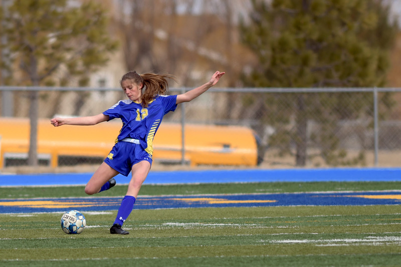 Matthew Gaston | The Sheridan Press<br>Sheridan's Ellie Williams (12) takes a free kick at Homer Scott Field Saturday, March 23, 2019.