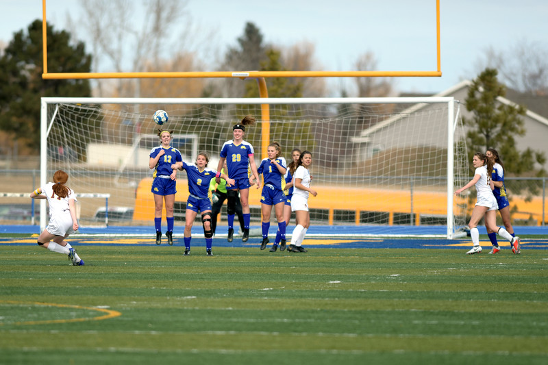 Matthew Gaston | The Sheridan Press<br>Larimie's Sam Turpen (17) capitalizes on the free kick with a well-placed chip shot over Sheridan's defensive wall at Homer Scott Field Saturday, March 23, 2019. The Lady Broncs fell to Laramie 1-0.