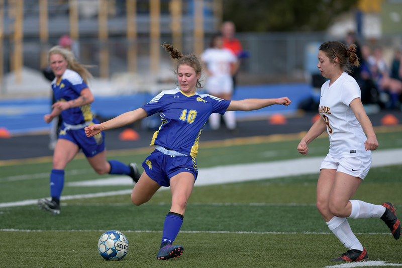 Matthew Gaston | The Sheridan Press<br>Sheridan's Aria Heyneman (10) crsses the ball into the center for a shot on goal against Laramie Saturday, March 23, 2019.
