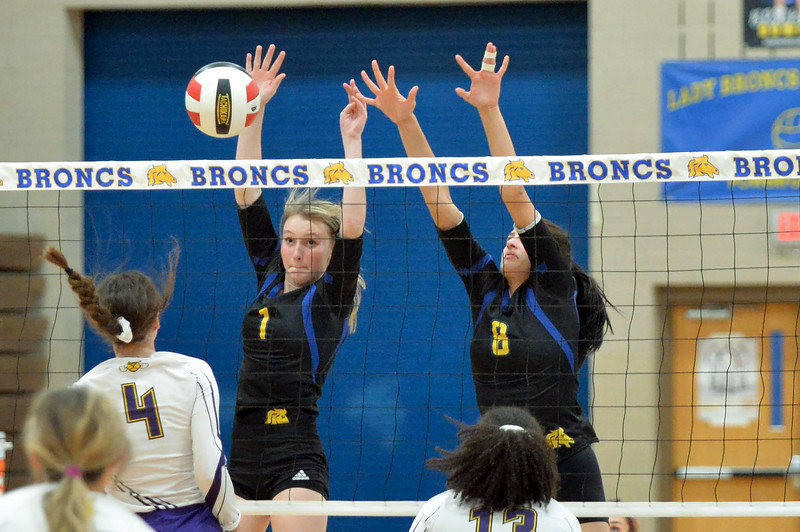 Joel Moline | The Sheridan Press<br /> Sheridan's Taylor Larsen (1) and Nadja Gale (8) combine for the block against Campbell County Friday, Oct. 25, 2019.