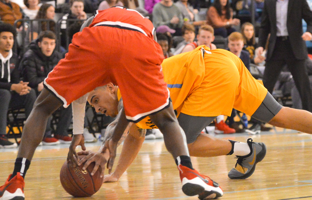 Justin Sheely | The Sheridan Press<br /> Sheridan's Caleb Stewart, right, fights for possession against Casper College at the Bruce Hoffman Golden Dome Saturday, Jan. 27, 2018. The Generals won 66-62.