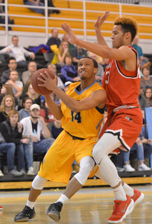 Justin Sheely | The Sheridan Press<br /> Sheridan College's Josh Bagley, left, shoots for two against Casper College's Zion Tordoff at the Bruce Hoffman Golden Dome Saturday, Jan. 27, 2018. The Generals won 66-62.